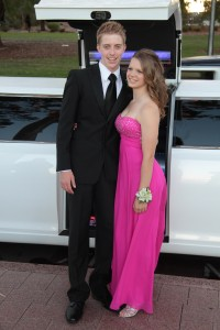Gorgeous young couple with impeccable formal dress with the impressive white chrysler limousine by Showtime Limos perth